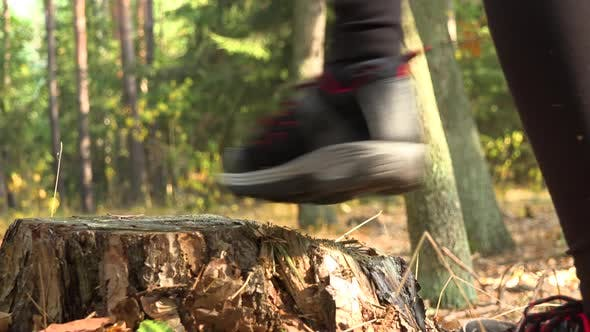 Thumbnail for A Woman Steps Onto a Stump, Looks Around, and Walks on - Closeup on the Stump