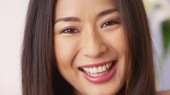 Cute Japanese woman smiling and laughing