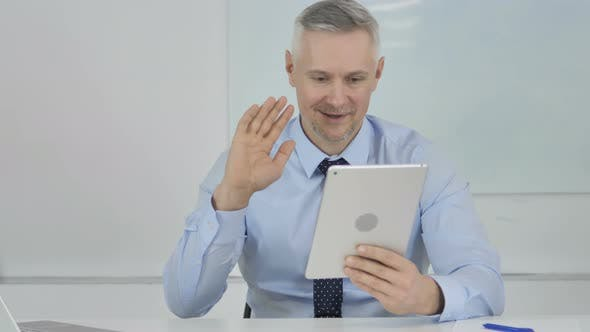Thumbnail for Online Video Chat By Senior Businessman Via Tablet