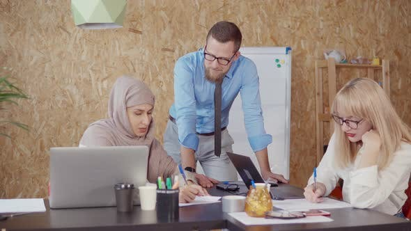 Thumbnail for Man, Blonde and Muslim Woman Are Discussing in Office Area in Working Day