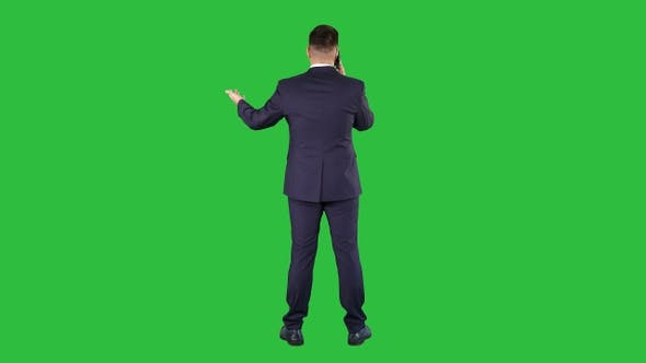 Thumbnail for Businessman with smartphone making a phone call on a Green