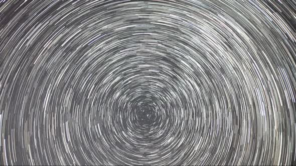 Thumbnail for Timelapse of moving star trails in night sky. The Milky Way galaxy rotating