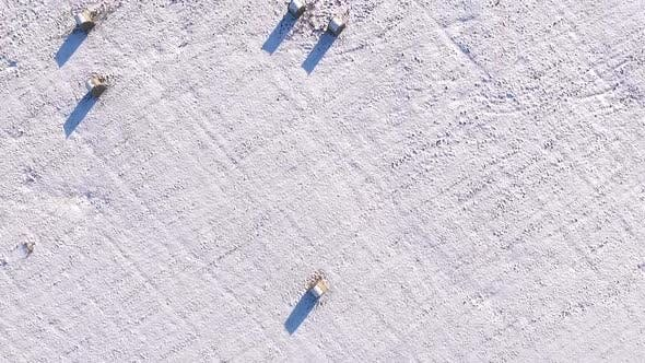 Abstract aerial view of drawings made with footprint in snow.