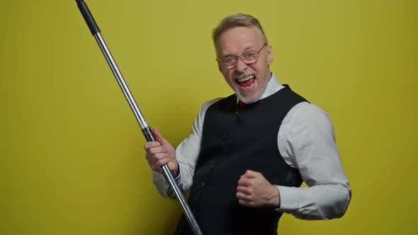 Thumbnail for Funny elderly man dancing with a mop