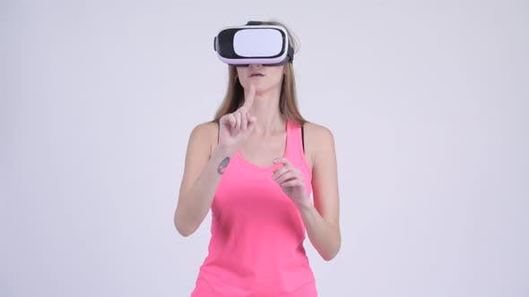 Thumbnail for Portrait of Blonde Woman Using Virtual Reality Headset