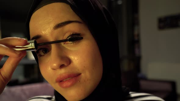Thumbnail for Muslim Woman Applying Mascara