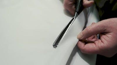 Scissors Cutting Cloth.