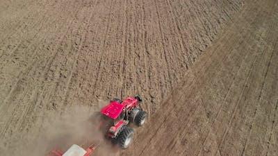 Tractor Cultivating Dusty Arid Farmland