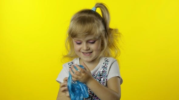 Thumbnail for Kid Playing with Hand Made Toy Slime. Child Having Fun Making Turquoise Slime. Funny Pupil Girl