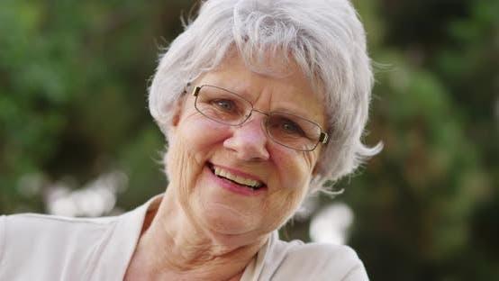 Thumbnail for Senior woman smiling and looking at camera