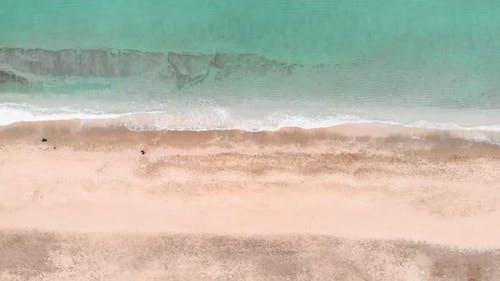 Empty beach with sea waves