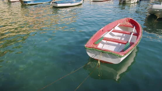 Thumbnail for Red Boat Anchored at the Sea port, A Small Fishing Boat. Italy.