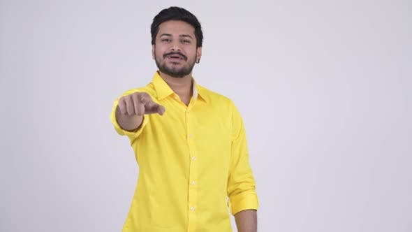 Thumbnail for Young Happy Bearded Indian Businessman Pointing at Camera