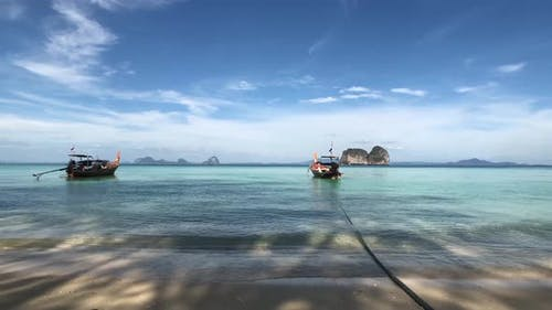 Long-tail boats close to the beach of Koh Ngai
