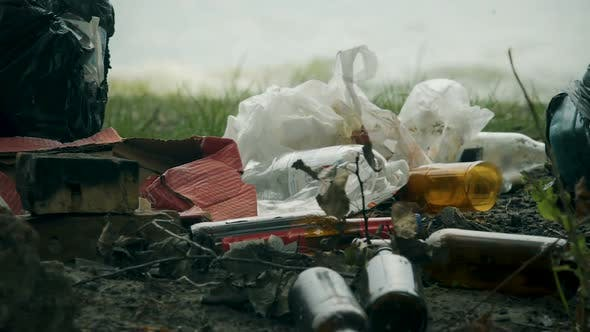 Thumbnail for Pile of Waste Plastic and Glass Left After Picnic Massive Consumption Problems