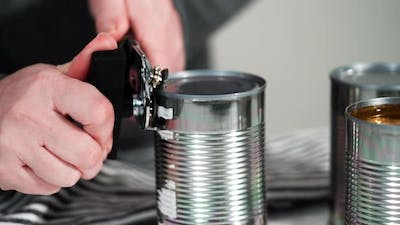 Opening canned white beans with can opener.