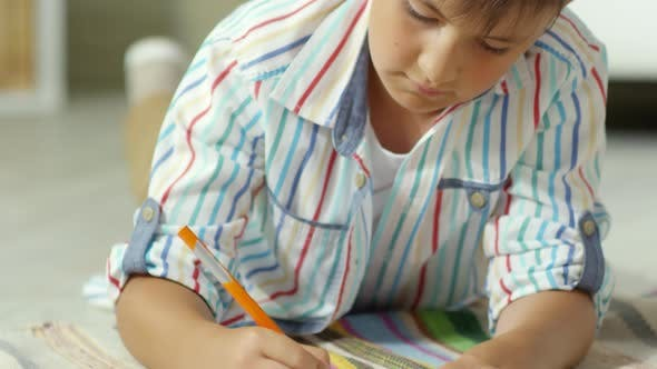 Thumbnail for Little Caucasian Boy Drawing Picture with Pencil