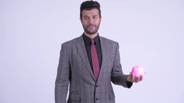 Thumbnail for Stressed Bearded Persian Businessman Holding Piggy Bank and Giving Thumbs Down