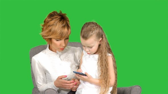 Thumbnail for Mmother and child playing game on the smartphone