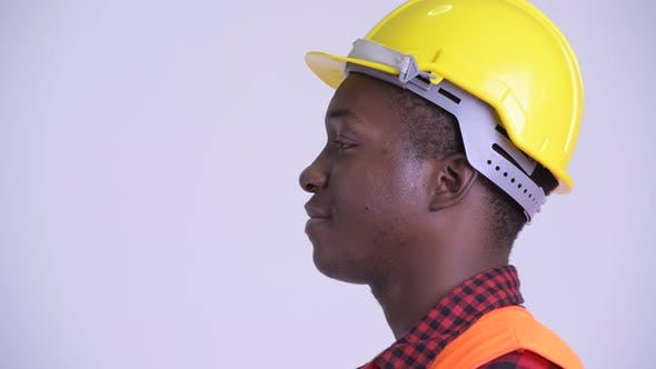 Thumbnail for Closeup Profile View of Happy Young African Man Construction Worker Smiling