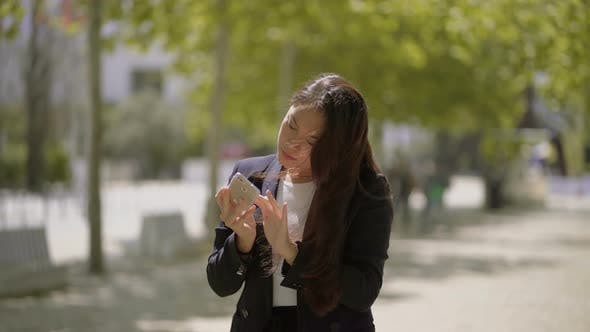 Thumbnail for Beautiful Asian Girl Photographing with Smartphone