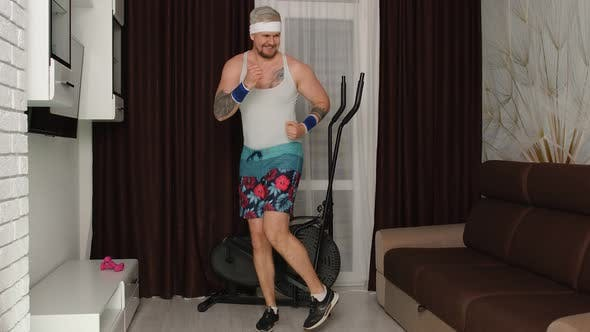 Thumbnail for Retrostyled Sportsman Man Running Dancing Making Faces Warming Up Before Fitness Training Home