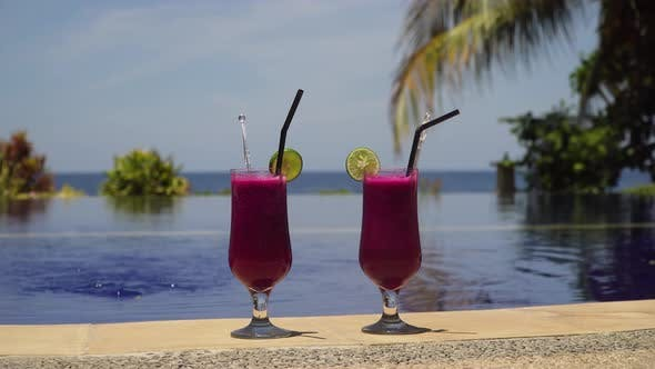 Thumbnail for Glasses with a Cocktail Near the Pool