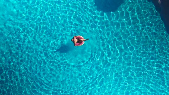 Girl in the Pool With an Inflatable Circle