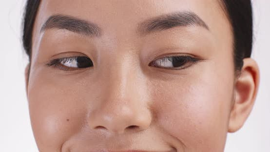 Thumbnail for Close Up Portrait of Cheerful Asian Lady Smiling at Camera Slow Motion