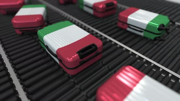 Thumbnail for Suitcases with Flag of Italy Move on the Conveyor in Airport
