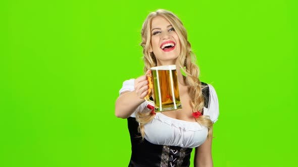 Thumbnail for Girl in Bavarian Costume Give Someone a Beer and Laughs. Green Screen