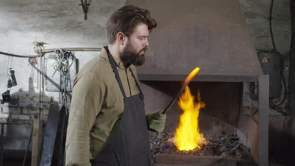 Cover Image for Professional Blacksmith Working in Workshop
