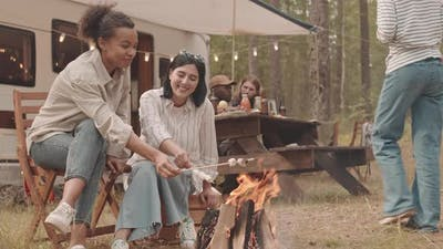 Girlfriends Making Fried Marshmallows on Campfire