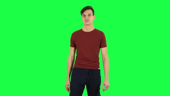 Cover Image for Guy Listens Attentively and Nods His Head Pointing Finger at Viewer. Green Screen