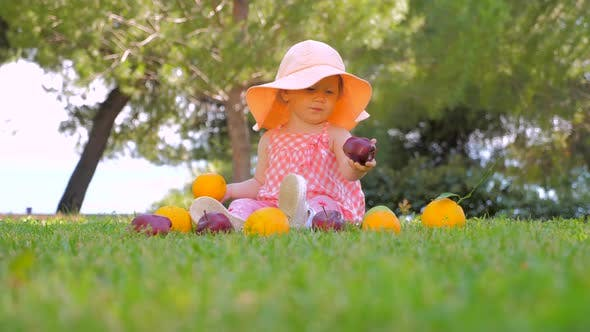 Thumbnail for Little Princess Playing with Fruits Outdoor. Child in Panama Having Fun Outdoor on Back Yard. Happy