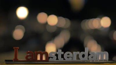 Amsterdam slogan and night city lights