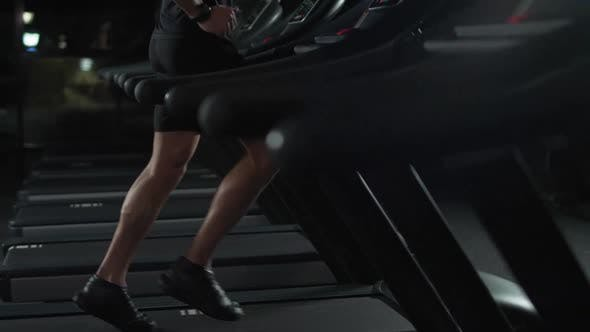Athletic Runner Man Run on a Treadmill Aerobic Exercise and Endurance Training in the Gym Motivation