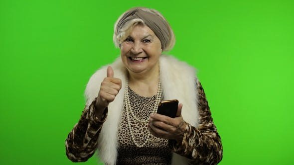Thumbnail for Elderly Caucasian Grandmother Woman Using Smartphone for Shopping. Chroma Key