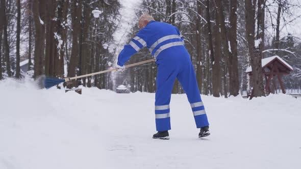 Thumbnail for Senior Cleaner Removing Snow.