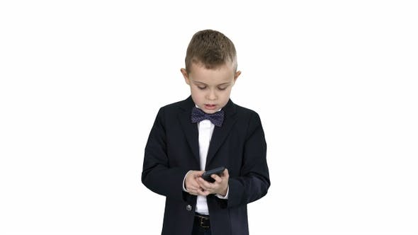 Cover Image for Small Boy in Costume Walking and Using Smartphone on White