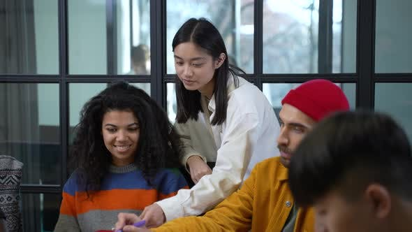 Focused Diverse Designers at Brainstorming Meeting