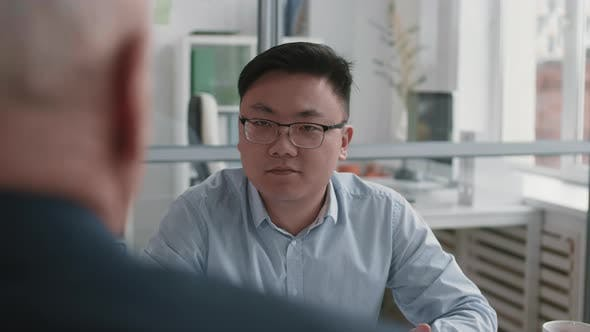Smart Asian Applicant Interviewed for Job