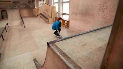 Skater Boy Enjoying Training in Skate Park