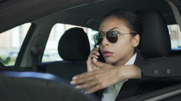Thumbnail for Businesswoman in Car Talking Over Mobile Phone Gesturing Angrily, Failed Deal