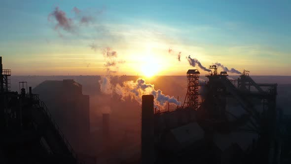 Aerial Forward Cityscape Sunset Factory Chimney Smoke Building Steam Thermal Power Plant
