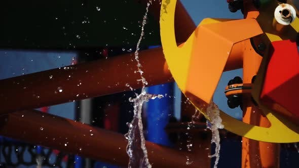 Thumbnail for Multicolored Circle in the Form of a Mill Spinning with Water .Slow Motion. Close Up
