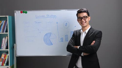 Asian Businessman With Whiteboard