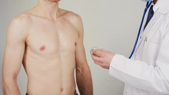 Thumbnail for Listening to patient's chest with stethoscope
