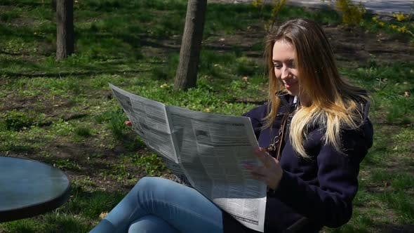 Thumbnail for Gorgeous Girl Reads Gossips in Newspaper.