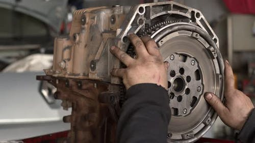 Flywheel Is Mounted To The Repaired Car Engine 4